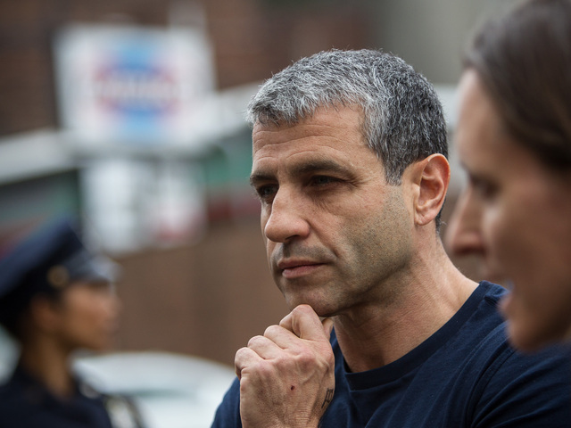 Dimitry Sheinman, 47, takes questions from the media at the 34th Precinct in Washington Heights on June 12, 2012.