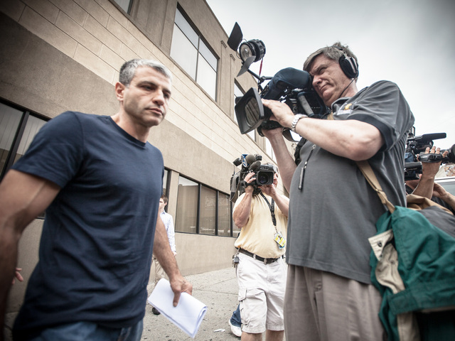 Dimitry Sheinman, 47, heads into the 34th Precinct in Washington Heights on June 12th, 2012 with what he said was one page of information ascertained clairvoyantly that pertains to the 2004 murder of Sarah Fox.