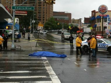 A female bicyclist was struck and killed by a truck at Bedford Avenue and Empire Boulevard Tuesday morning, officials said.