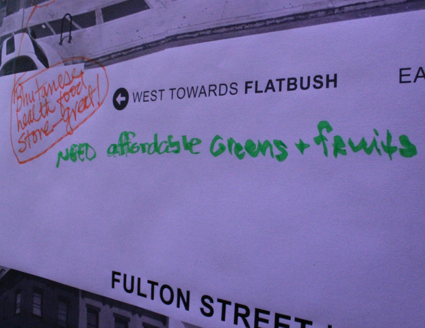 Participants write suggestions for Fulton Street on the wall.