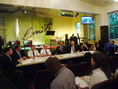 Bronx City Councilman Fernando Cabrera, center, and  officials from a number of city agencies met with tenants from 2400 Webb Ave. on June 12, 2012. The residents were forced from their homes after management illegally removed the building's fire escapes.