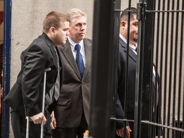 <p>Officer Richard Haste arrives at his arraignment at Bronx Supreme Court on June 13, 2012.</p>