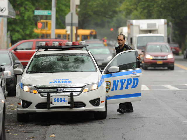 A police officer at the scene of the shooting on Avenue W on June 13, 2012.