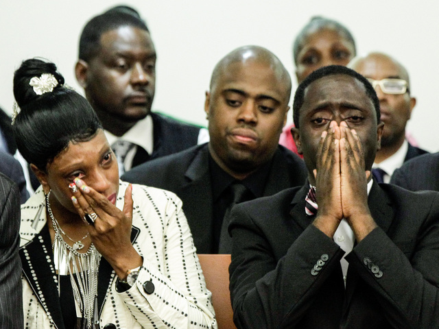 <p>The parents of slain teenager Ramarley Graham attend the arraignment of NYPD Officer Richard Haste in the Bronx Supreme Court on June 13, 2012.</p>