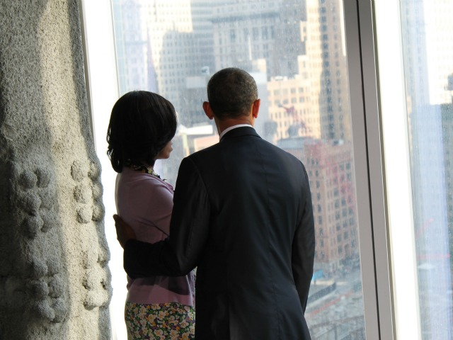<p>President Barack Obama and his wife Michelle Obama shared a quiet moment looking out over the 9/11 Memorial June 14, 2012.</p>