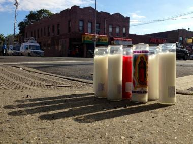 Candles sat at the East Flatbush intersection where 23-year-old Shantel Davis was shot and killed by police after crashing a stolen car, according to the NYPD.