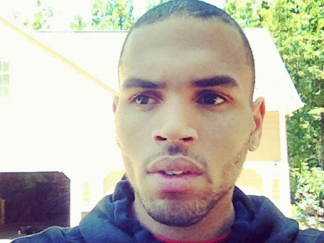 A day after his crew fought with Drake's entourage at a SoHo nightclub over their affections for Rihanna, Chris Brown tweeted a picture of himself on June 15, 2012.