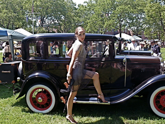 Uptown style meets gangster's moll at the vintage car display