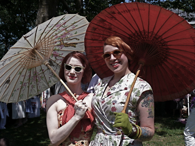 Darlene E. and Annabella Z. stroll the venue in 1930 style dresses, parasols and hipster ink