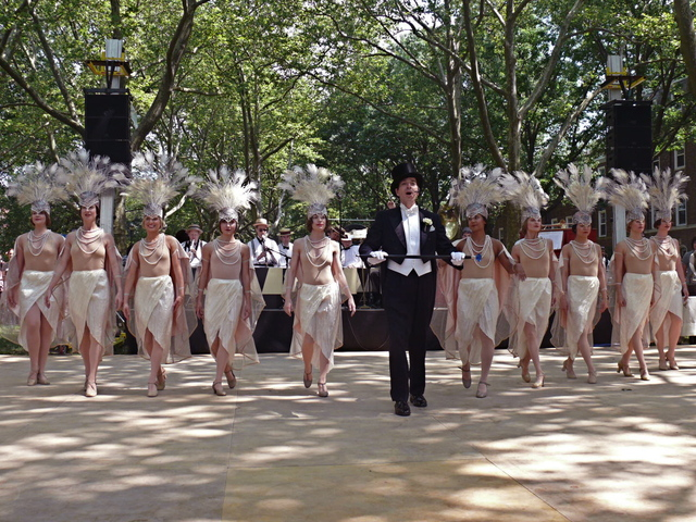Gregory Moore performs with the Dreamland Orchestra Follies Dancers, costumed sheer tones of nude, blush and Ostrich feathers