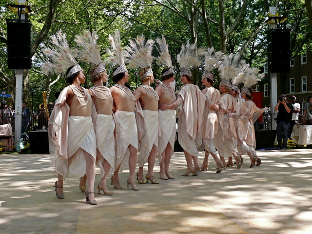 The Dreamland Orchestra Follies Dancers perform vintage showgirl style steps
