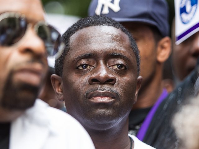 Franclot Graham, whose son Ramarley Graham was shot to death by an NYPD officer inside his Bronx home, participates in a Silent March against stop and frisk on Father's Day June 17th, 2012.