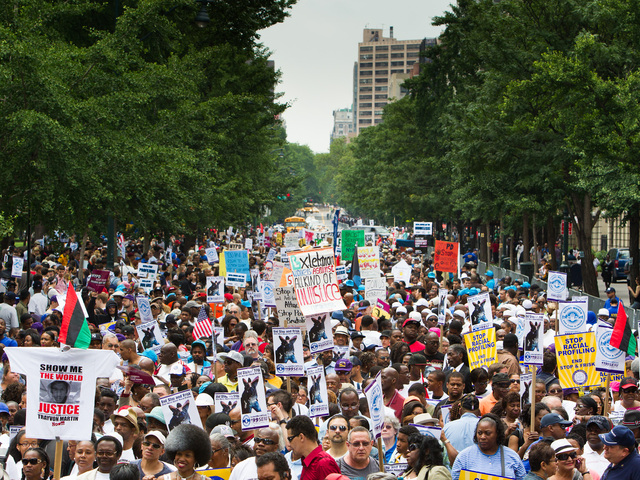 Thousands join the first Silent March against the NYPD Stop-and-Frisk policy outside Central Park on June 17th, 2012.