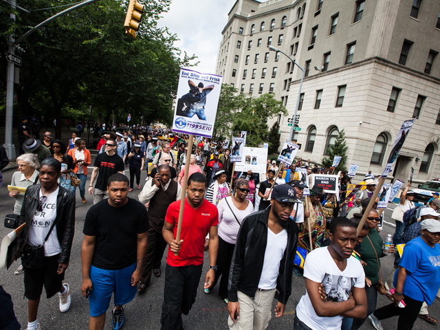 Thousands stream down 5th Ave at the first Silent March against NYPD Stop-and-Frisk policy on June 17th, 2012.