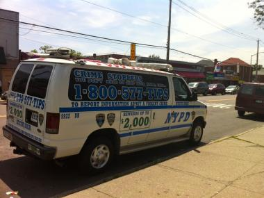 A police Crime Stoppers van outside the Pelham Parkway Houses in June, shortly after 88-year-old Evelyn Shapiro was brutally beaten to death there.