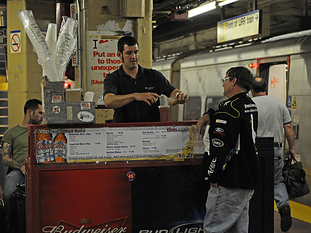 Vendors sell cold drinks at Penn Station for a the air conditioned ride on the Long Island Rail Road.