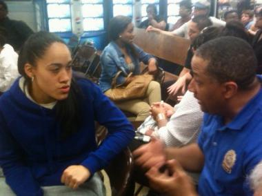 Community Affairs Officer Dean Elmore spoke with a teen about stop-and-frisk at an 83rd Precinct Community Council meeting Tuesday, June 19, 2012, in Bushwick.