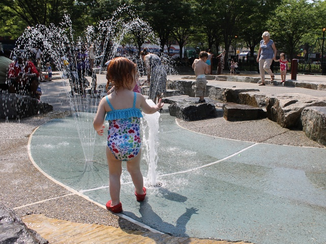 The water features at the newly renovated J.J. Byrne playground on Fifth Avenue in Park Slope were crowded with splashing kids on Wednesday.