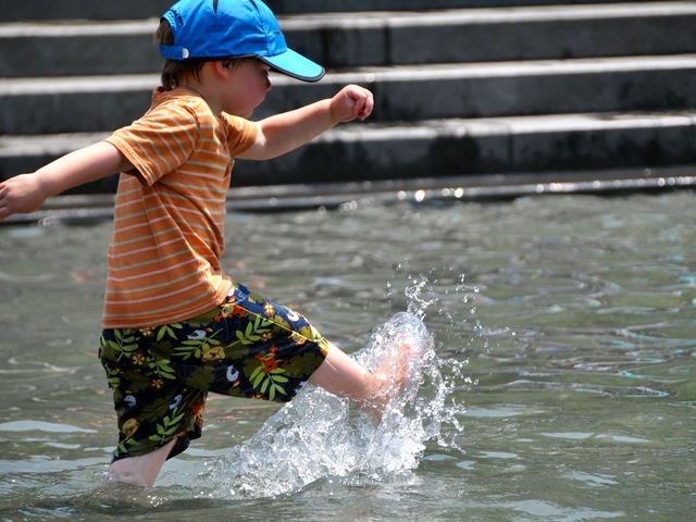 Cash Kojen, 3, playing in the water in Washington Square Park during his trip to the city from California.