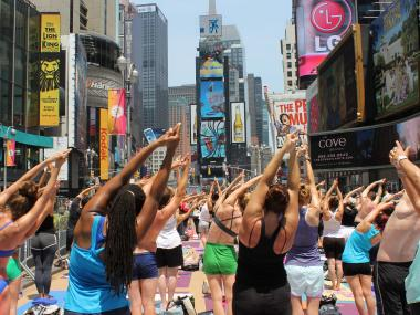 Over 14,000 people turned out for the Bikram Yoga class celebrating the summer solstice on Wed. June 20, 2012.
