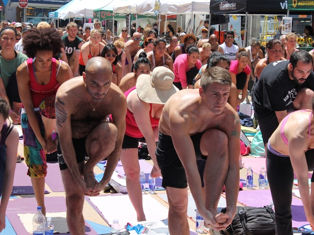 Thousands of yogis turned out for a free Bikram Yoga class in Times Square on June 20, 2012.