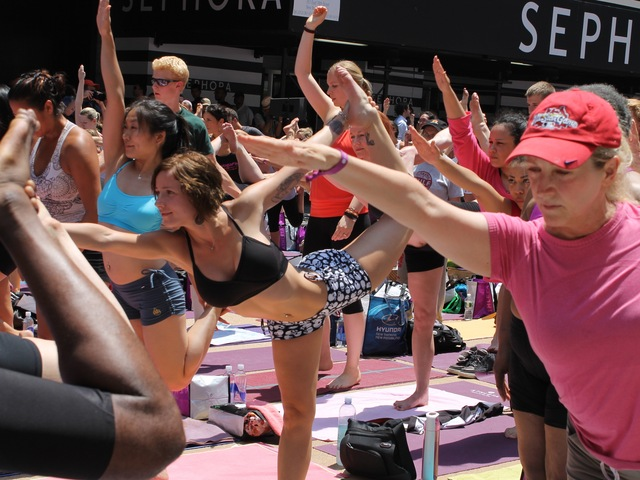 <p>Thousands of yogis turned out for a free Bikram Yoga class in Times Square on June 20, 2012.</p>