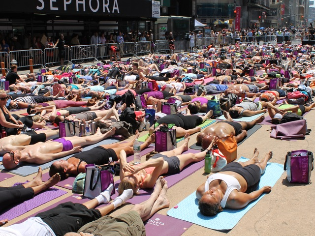 <p>More than 14,000 people turned out for the Bikram Yoga class celebrating the summer solstice on Wednesday June 20, 2012.</p>
