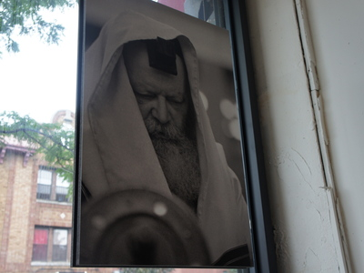 This image is among the first pictures Israeli photographer Yossi Melamed made of Menachem Mendel Schneerson, the seventh Lubavitcher Rebbe and the spiritual center of Crown Heights' Hasidic community.
