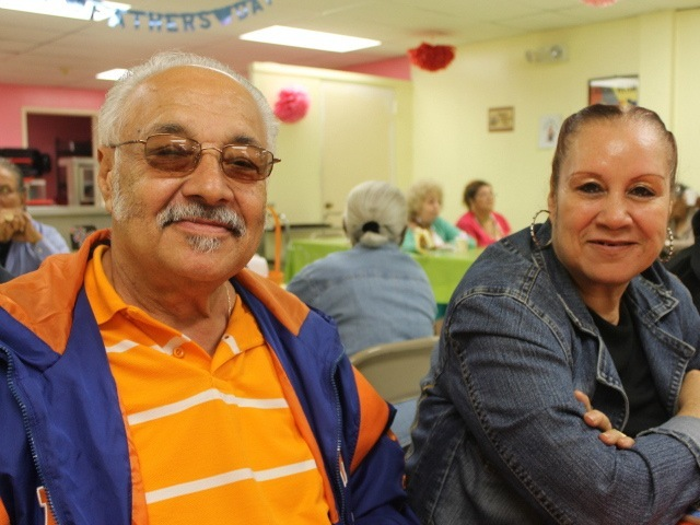 Augustine Gonzalez (left) and Anna Colon in an air-conditioned senior center in The Bronx on June 20, 2012.