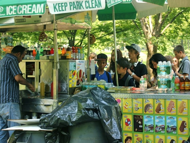 Children line up to buy ice treats on June 20, 2012.