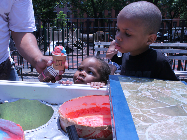 Chariya,6, and Ezekiyai,2, Lumsden wait for ice cream in Underwood Park, in Clinton Hill, Brooklyn.