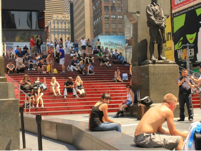 <p>Some people shed their shirts to cool off in Times Square June 21, 2012.</p>