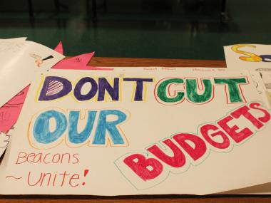 Signs from the students of the Forest Hills Beacon protesting the program's closing