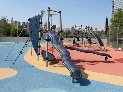Gantry Plaza State Park Playground has a very modern design and is full of bright colors.