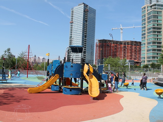 The flooring, covering the entire Gantry Plaza State Park Playground, is extremely soft and shock-absorbent.