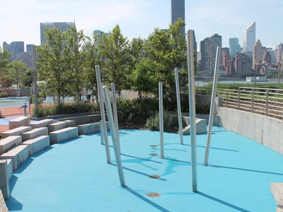 A modern splash pad has opened in summer at Gantry Plaza State Park Playground.