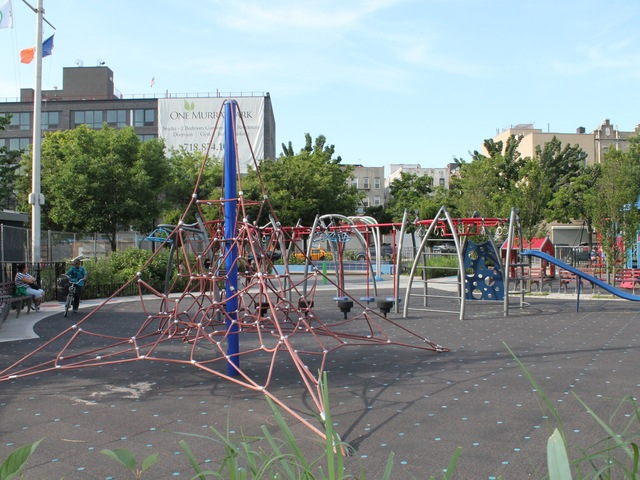 A spiderweb-like climbing structure at Murray Playground.