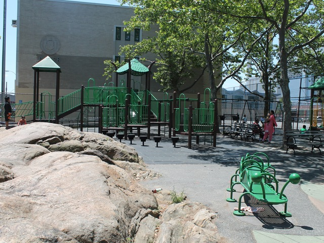 Spirit Playground has a jungle gym and a rock that children like to climb on.