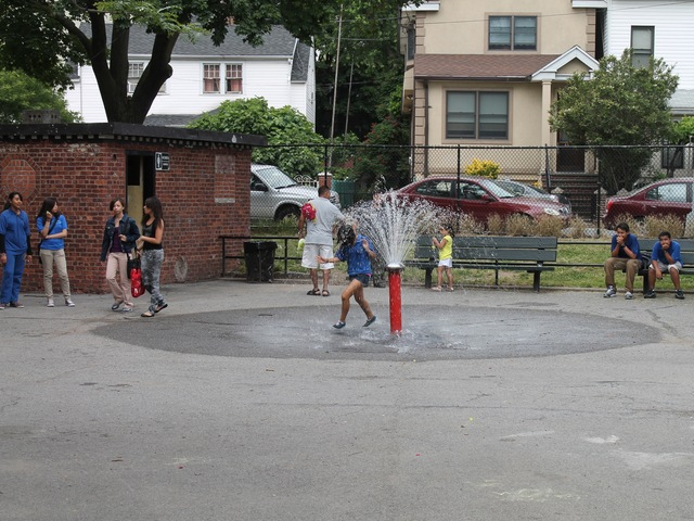 Astoria Heights Playground has sprinklers and a pool that will open the day after school closes.
