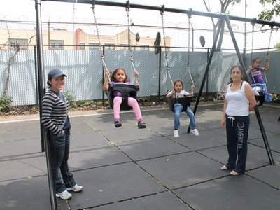 Juana Garcia (left) and her 5-year old daughter Joanna play at Playground Thirty Five XXXV