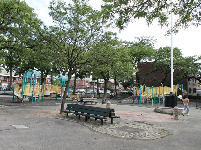 Raimonda Playground has several sitting areas with benches and game tables.