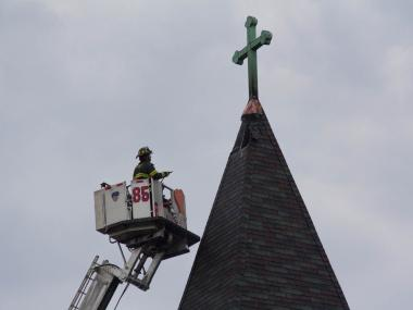 Firefighters battle a blaze after lighting struck the steeple at St. Anthony of Padua on Victory Boulevard on Staten Island Monday, June 25, 2012.