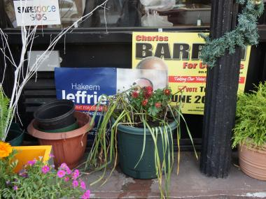 A cafe on Tompkins Avenue in Bed-Stuy, Brooklyn, displays a sign supporting both New York State Assemblyman Hakeem Jeffries and New York City Councilman Charles Barron for Congress.  Both are fighting for the Democratic party nomination in Brooklyn's newly-created 8th Congressional District, and Bed-Stuy is expected to decide the election.