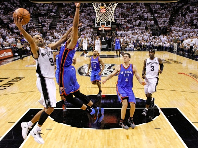 Tony Parker of the San Antonio Spurs goes to the hoop against Russell Westbrook of the Oklahoma City Thunder in Game Five of the Western Conference Finals of the 2012 NBA Playoff June 4, 2012 in San Antonio, Texas.
