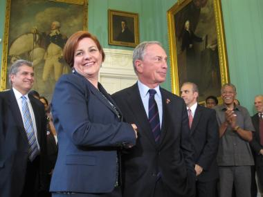 Mayor Michael Bloomberg and City Council Speaker Christine Quinn shake hands on a final budget deal for Fiscal Year 2013.