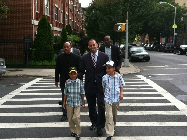Hakeem Jeffries walks with his two sons on Tuesday, June 26, 2012, on his way to vote at P.S. 9 in Brooklyn.