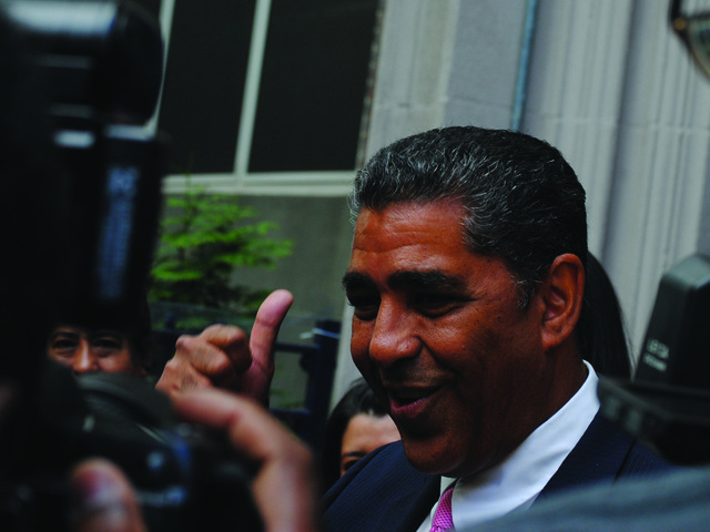 Adriano Espaillat speaks to reporters outside P.S. 98 in Inwood after voting in his primary race against Rep. Charles Rangel on Tuesday, June 26, 2012.