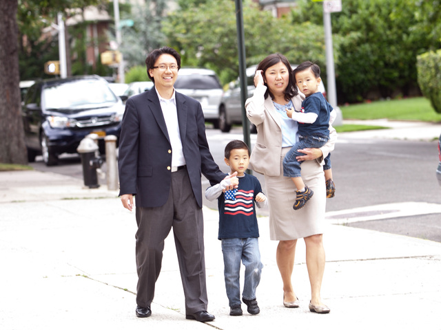 Grace Meng — joined by husband Wayne Kye and their two sons Tyler, 4, and Brandon 2 — walks to the St. Andrew Avellino School in Flushing to cast her vote on Tuesday, June 26, 2012.
