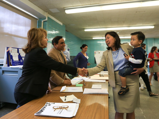 Grace Meng greets a poll worker at the St. Andrew Avellino School in Flushing on Tuesday, June 26, 2012.