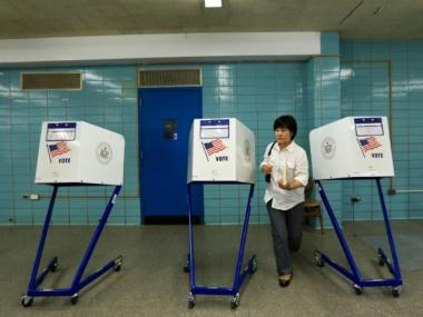 Eunsook Cho, 54, votes at a mostly-empty polling station in Queens.
